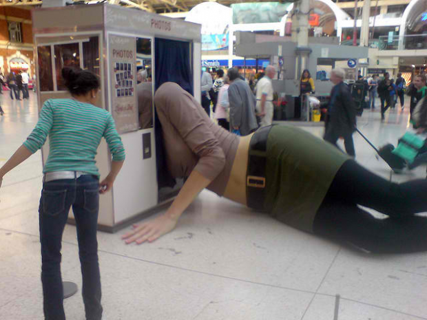 19-Giant Woman Lying in a Photo Booth, London, England
